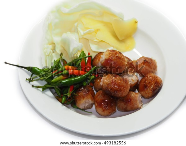 Thai northeast sausage beef or pork eat with chili ginger and cabbage, Thailand street foods, Isolated.