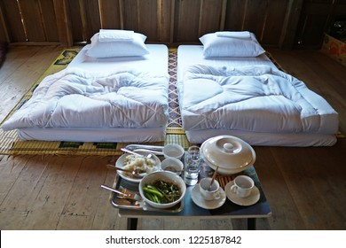 Thai northern local breakfast on bed  Shrimp Paste Chilli Sauce (Nam Prik Ka Pi)with vegetable set,with tea or coffee cups in traditional Thai homestay.Karen village.Thai local food in Wooden homestay