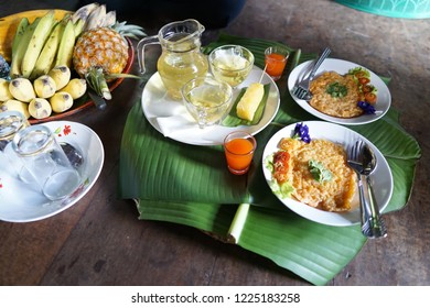 Thai northern local breakfast with rice omelet and fresh mixed fruit salad,banana pineapple with Chrysanthemum tea cups in traditional Thai homestay.Karen village.Thai local food in Wooden homestay.