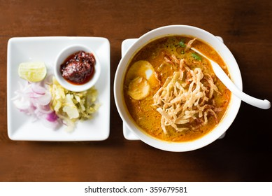 thai northern style curry noodle - Kao Soi (selective focus on food in the bowl)