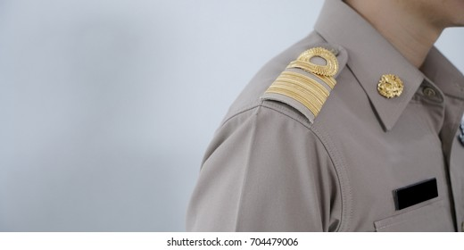 Thai officials in uniform on the white backdrop.