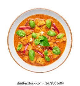 Thai Panang Chicken Curry isolated on white background. Phanaeng Curry is thai cuisine dish with chicken, kaffir lime leaves, red curry sauce and vegetables. Thai food. Thailand meal