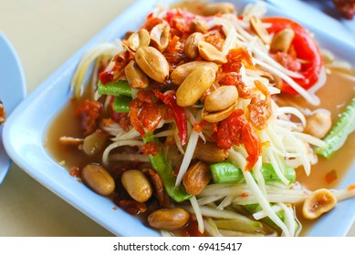 thai papaya salad hot and spicy mixed from variety of vegetable closeup
