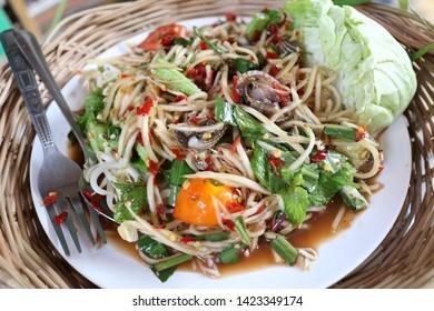 Thai papaya salad put cockles  very yummy