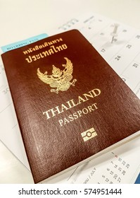 Thai passport on calendar with white tripped pin