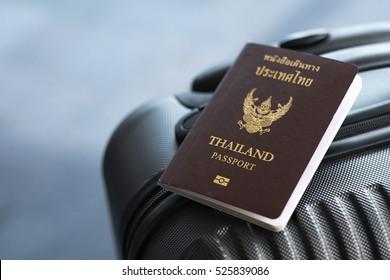 Thai passport on suitcase, Travel concept.