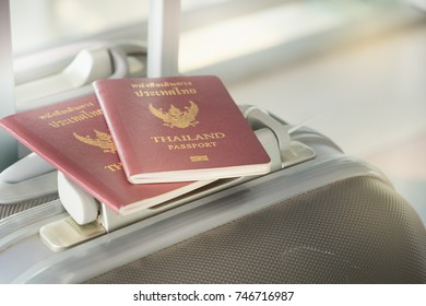 Thai passports are placed on luggage in the international airport of business travelers who are flying to business meetings and traveling by plane to foreign countries.