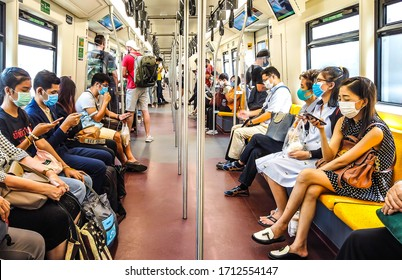 Thai people and foreign travelers are wearing medical face mask while traveling on BTS public transportation to protect themselves from pandemic Coronavirus Covid-19, Bangkok, Thailand, 25 March 2020