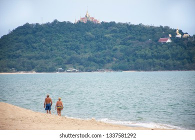 Thai people and foreigner travelers walking visited and resting at Ban Krut Beach in Prachuap Khiri Khan, Thailand