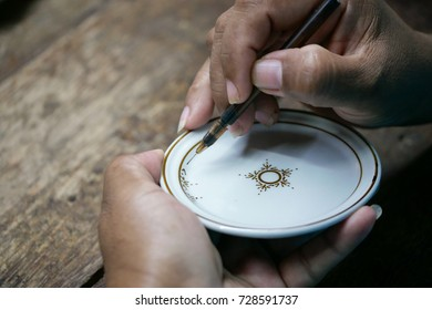 Thai people painting on benjarong ceramic ware. A traditional Thai five-colored famous porcelain. process of painting Ceramic Benjarong