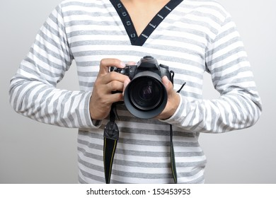 Thai photographer using a professional DSLR camera