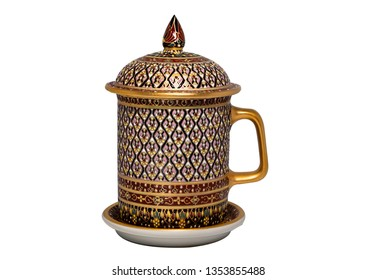 Thai porcelain benjarong ceramic mug. Benjarong ware is a kind of painted Thai ceramics porcelain, isolated on white with clipping path