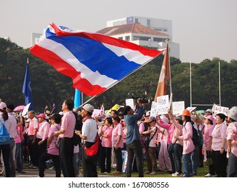 Thai Protesters carry flags and banners march toward central Bangkok on Monday, Dec 9, 2013(International Anti Corruption day)to raise pressure on the government of Shinawatra regimes to step down.