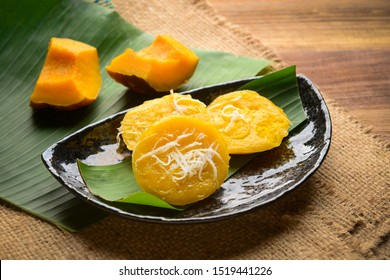 Thai Pumpkin Cakes(Kanom Fak Thong) Steamed Pumpkin Cake,Make from pumpkin, sugar, Flour, tapioca flour, grated coconut, salt and coconut milk, taste delicious.