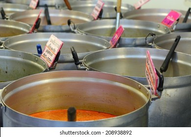 Thai red curry selling in the big pot in the market
