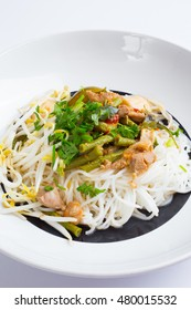 Thai rice vermicelli served with curry and vegetable on white background