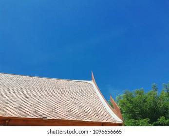 Thai roof style on the blue sky background.