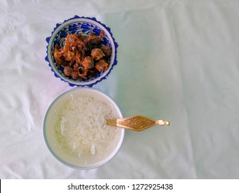 "Thai Royal Cuisine, Rice in ice water with side dish.Royal Thai Cuisine ""Kao Chae"" Cooked jasmine rice soaked in iced water served with complementary food"