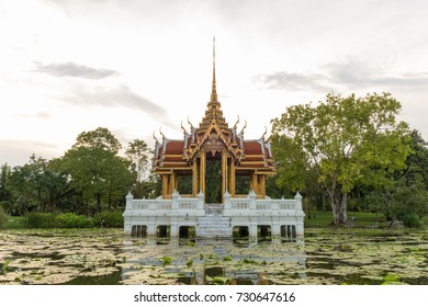 Thai royal pavilion mock in the Park. Public Domain mock reflective surface on lotus pond in white sky.