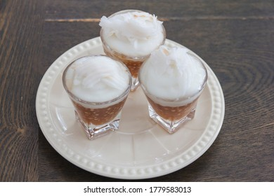 Thai Sago Dessert over topping with coconut milk contain in small glass, appetizing