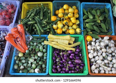 Thai small purple and other colors eggplants on the market. Beautiful Background.