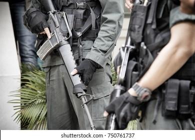 Thai soldier holding m16 gun in full army uniform.Thai military in Thailand curfew zone