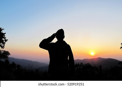 Thai Soldier saluting with sunset background,Silhouette