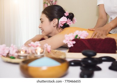 Thai Spa therapy on the girl lay on bed with many item around, spa and massage concept