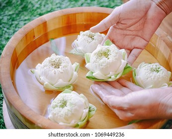 Thai Spa treatment hand and manicure nails spa wet with lotus flowers