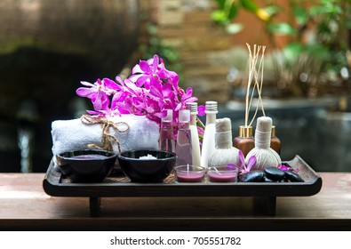 Thai Spa Treatments aroma therapy  salt and sugar scrub and rock massage with orchid flower.  Healthy Concept.