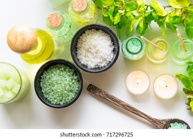 Thai Spa Treatments aroma therapy  salt and nature green sugar scrub and rock massage with green orchid flower on wooden white with candle. Thailand.  Healthy Concept. copy space,select and soft focus