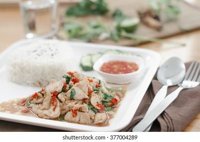 Thai spicy food, stir fried chicken whit basil on rice in Thailand ThaiStyle