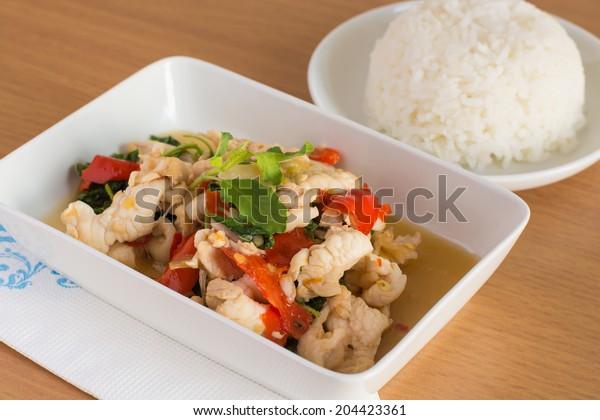 Thai spicy food, stir fried chicken whit basil on rice.