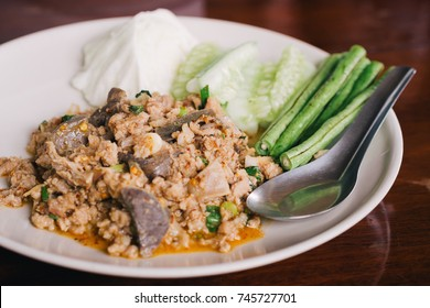 Thai Spicy Minced Pork Salad aka Larb Moo seasoned with fish sauce, chili flakes, lime juice, toasted crunchy sticky rice, and fresh herbs