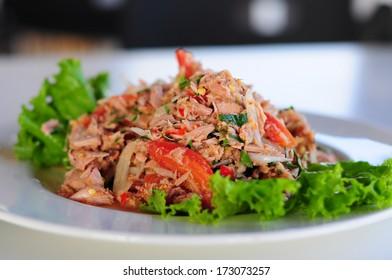 Thai spicy tuna salad with onion and tomato
