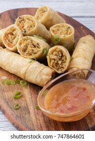 thai spring rolls with sauce and green vegetables