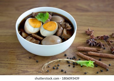 """Thai Stewed belly pork and Eggs with spices thai food thai called  """"Palo"""" / Select focus and space for text"""