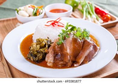 Thai stewed pork leg with rice (Kao Kha Moo)