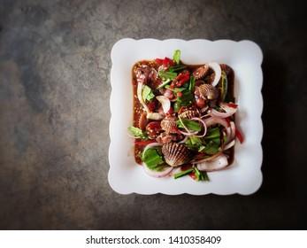 Thai street food concept : Spicy blood cockle salad ( Tum Hoi Klang)