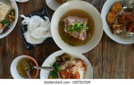 Thai street food on wood table.