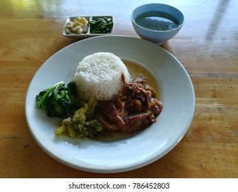 Thai Street food pork leg stewed served with streamed rice.