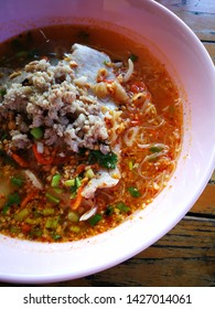 Thai street food Spicy Tomyum noodle soup with pork balls, Boiled Eggs. Asian spicy seafood noodle soup.