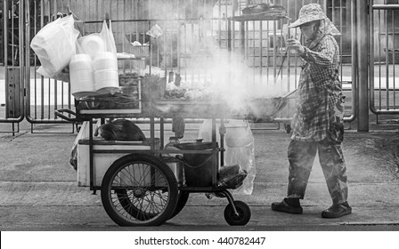 Thai street food vendor in Bangkok, Thailand. Black and white.