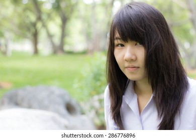 thai student teen relax Sitting On Park
