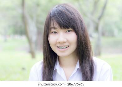 thai student teen relax Sitting On Park
