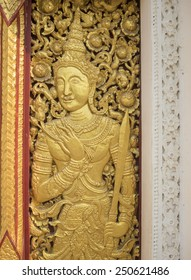 Thai style angel at door in temple of Thailand.