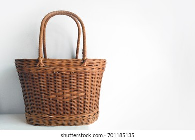 Thai style bamboo wooden brown handmade bag, wicker, basket, object with handle isolated on white background
