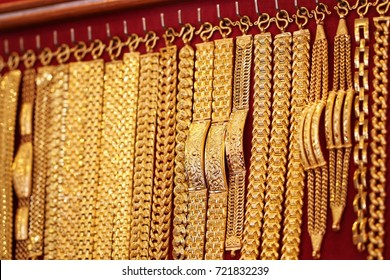 Thai style collection gold jewelry bracelet 96.5% hanging on red velvet background at gold shop, many design are popular and fit for man customer , gold ornament ship business