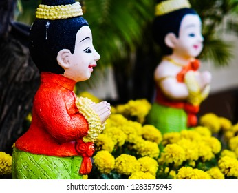 Thai style dall red shirt yellow flower