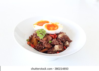 Thai style fried brown rice with boiled eggs, chicken, sausage, taro and vegetable.